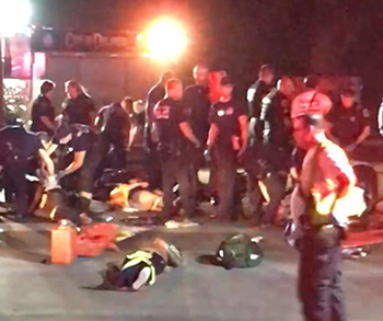 First responders crowd around victims from a mass shooting at an Orlando, Fla.. (photo credit - NYDaily News)